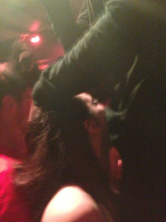 Female fan blows Danny Brown during a concert